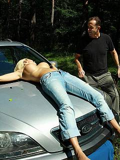 tied hood woman Naked of car to