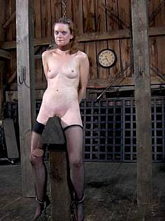 Woman bondage wooden pony