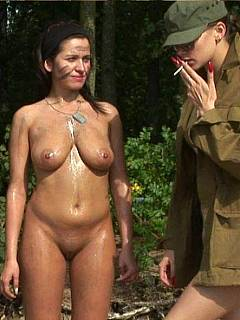 Busty girl is crawling naked in the sand during her army training course