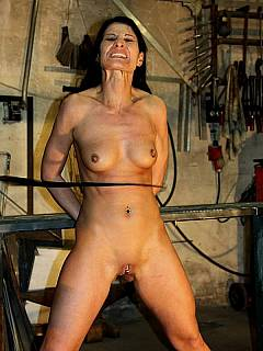 Hot MILF is begging the guy to let her go but he puts her in bondage naked and lashes her belly
