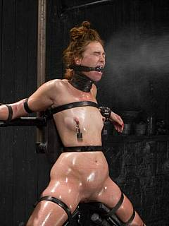 Redhead is tortured with extreme bondage where her body is becoming twisted with steel and leather