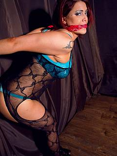Strappado bondage pose for an attractive MILF dressed in lingerie and pantyhose