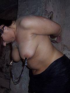 MILF plumper if kept semi-stripped and tied up in the basement