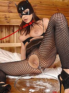 Horny catwoman gives herself a milk enema