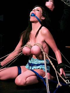 Woman is tied by her saggy tits and then tortured with mask put over her face