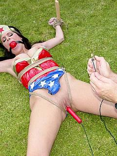 Wonder Woman is cativated, left tied spread eagle on the lawn and there is a bomb shoved into her pussy. The fuse is burning!