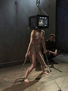 Nude woman is suffering bondage pain while having her head boxed or wrapped in plastic