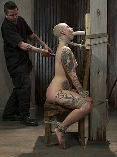Shaved and tattooed slut is having hard times when in hands of a professional bondage rigger