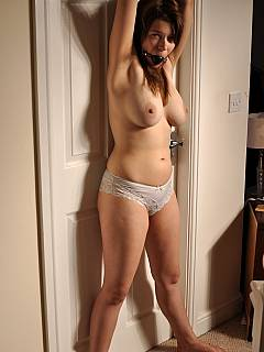 above head tied Naked women hands