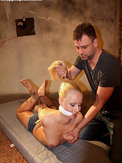 Barefoot blond is in a tight hogtie: being hair-pulled and having her boobs grabbed