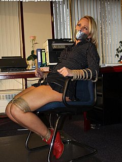 Rope works fine for binding and duct tape for gagging when captivating an office gal