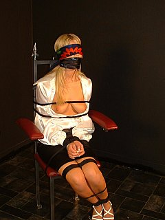 Hot blond is bound in the dark, gagged, blindfolded and got her blouse unbuttoned