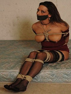 Semi-naked abducted damsel has very low chances of escaping because her rope bondage is extremely tight