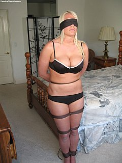 Housewife is going to stay in her bedroom tied up and blindfolded while her house is getting robbed