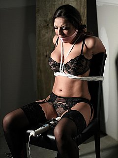 Making chair tie much more exciting for helpless lingerie beauty by placing a vibrator in close contact with her crotch