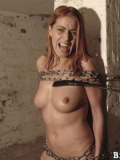 Extreme BDSM fun where naked gal is tied to the post with chains and whipped cruelly