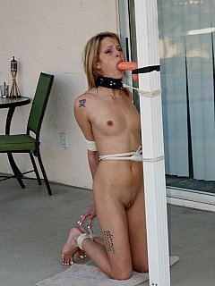 Sexy gal was tied to the post for a continuous dildo-sucking training but she managed to break loose and trying to escape with crawling