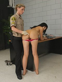 Stripping down and quick examination is what cuffed whore to be subjected before going behind the bars