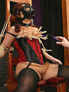 Tormenting lovely lady iwth rope restraints, gas mask and loads of clothes pegs all over her boobies