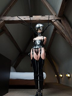 Gal was tormented with bondage, head mask and bizarre steel ball over her head but now int is over and she can rest