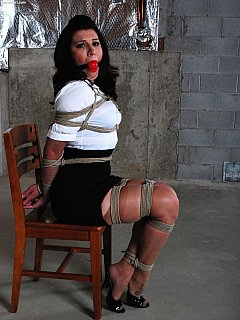 Elegant teacher is truing to look as best as possible and sit straight even when she is subjected to rope bondage and gagging