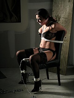 Chair bondage is the first part of the girl tease. The second is the vibrating sex toy in between her legs that makes it all even more exciting