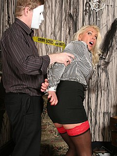 Masked criminal is using force to put hot blond bimbo into bondage submission