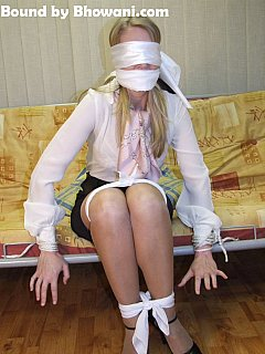 Cloth gag and blindfold are making tied up office girl totally helpless
