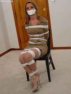 Looks like students tied their teacher up, gagged and runaway from class leaving her alone and helpless