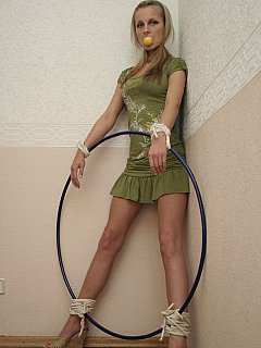 Sport gear can be used for bondage play: there is blond gagged with ping-pong ball and tied to the hoop