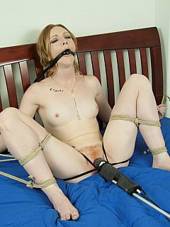 Petite blond is making sexy moans when tied and teased in her bed