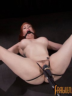 Pussy teasing would make spread redhead scream but ball gag keeps her silent