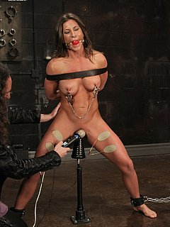 Slave Ariel is just can't get enought of bondage: she loves her muscular body to be punished severely